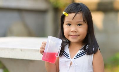 young-asian-girl-holding-pink-drink